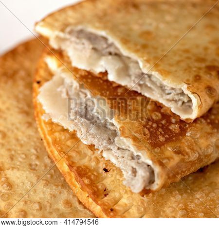 Puff Pastry Pie Stuffed With Meat Filling. Fresh Cheburek, Fried Bread With Meat. Delicious Snack Or