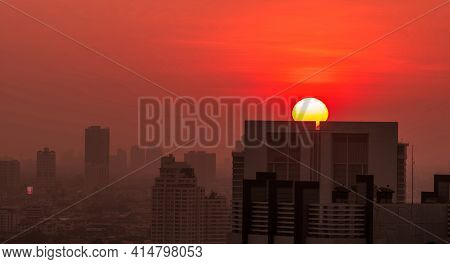 Cityscape In The Morning With Sunrise Sky And Air Pollution. Fine Dust Of Pm 2.5 Cover City. Citysca