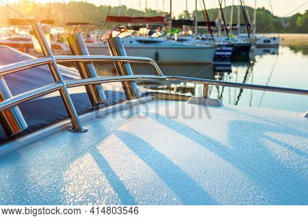 Close Up View Of Motor Boat Bow With Morning Dew In Sunlight. Motor Boat Moored In A Lake Harbour Ea