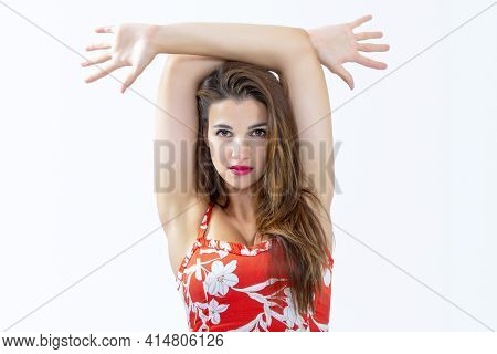 Pretty Caucasian Long-haired Woman 30-35 Years Old. With Arms Above Head And Gaze Straight Ahead