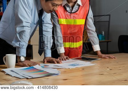 Warehouse Manager And Worker Working In The Storehouse . Logistics , Supply Chain And Warehouse Busi