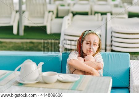 The Girl Is Drinking Tea. Teenage Girl In A Summer Cafe.