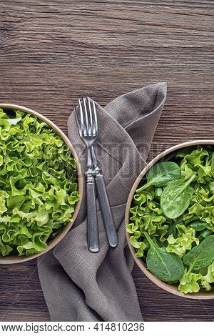 Healthy Green Salad On Wooden Table Background. Healthy Salad Meals.
