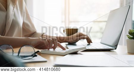Close Up Hand Of Woman Using Computer Calculating Household Finances Or Taxes On Machine, Female Man