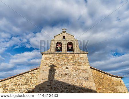 Bottom View Of Antique Belfry Under Cloudy Sky