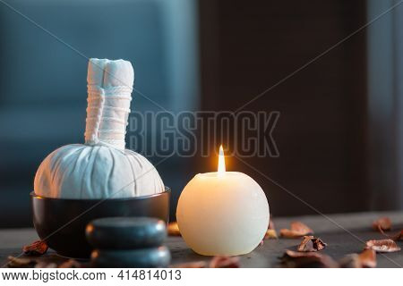 Spa Background. Towel, Candles, Flowers, Massaging Stones And Herbal Balls. Massage, Oriental Therap