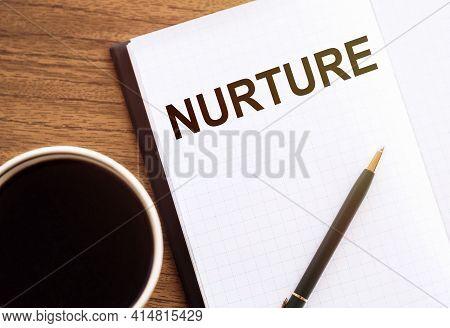 Nurture - Text On Notepad On Wooden Desk.