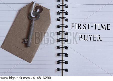 Text Written On Notebook With House Key - First Time Buyer