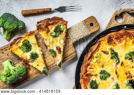Homemade Quiche Tart With Red Fish And Broccoli. White Background. Top View