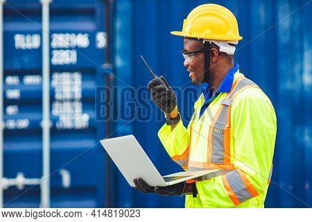 Black African Happy Worker Working In Logistic Communication Using Radio And Laptop To Control Loadi