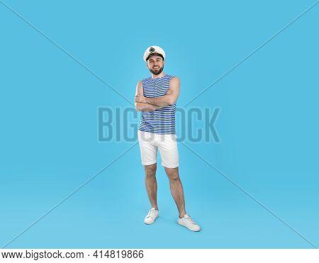 Full Length Portrait Of Sailor On Light Blue Background