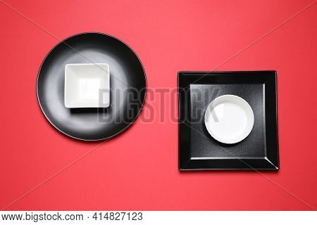 Set Of Ceramic Dishware On Red Background, Flat Lay
