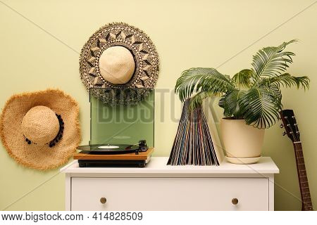 Stylish Room Interior With Turntable And Collection Of Vinyl Records