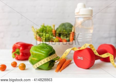 Diet Healthy Food And Lifestyle Health Concept. Sport Exercise Equipment Workout and gym Background