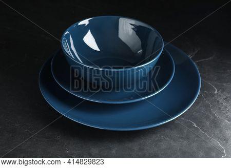 Empty Clean Ceramic Dishware On Grey Table, Closeup