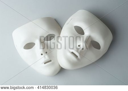 White Theatre Masks On Grey Background, Flat Lay
