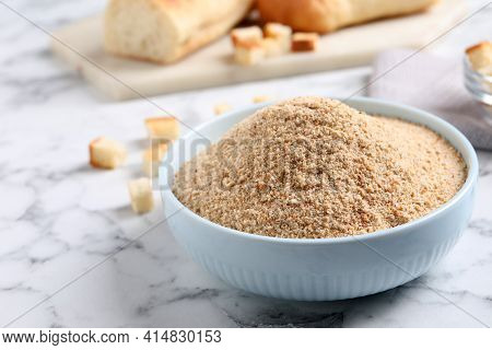 Fresh Breadcrumbs In Bowl On White Marble Table