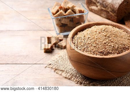 Fresh Breadcrumbs In Bowl On Wooden Table. Space For Text