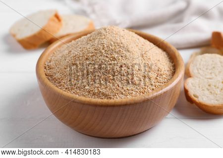 Fresh Breadcrumbs In Bowl On White Wooden Table