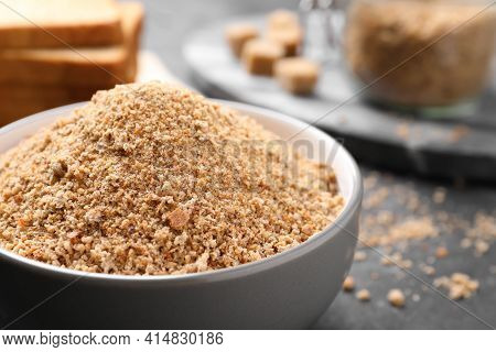 Fresh Breadcrumbs In Bowl On Black Table, Closeup