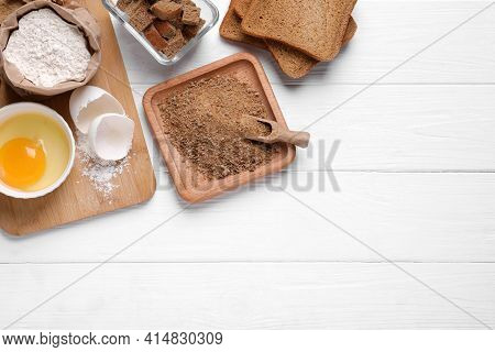 Fresh Breadcrumbs, Flour And Egg On White Wooden Table, Flat Lay. Space For Text