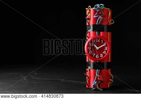 Explosive Dynamite Time Bomb On Black Background. Space For Text
