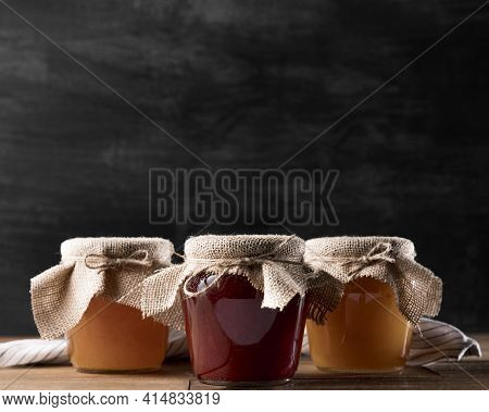 Front View Jam Jars With Copy Space. High Quality And Resolution Beautiful Photo Concept