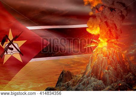 Big Volcano Blast Eruption At Night With Explosion On Mozambique Flag Background, Suffer From Erupti