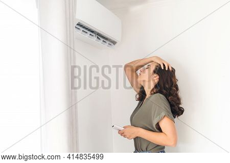 Suffering From Summer Heat Young Woman Stands Under Stream Of Cool Fresh Air From Air Conditioner, H