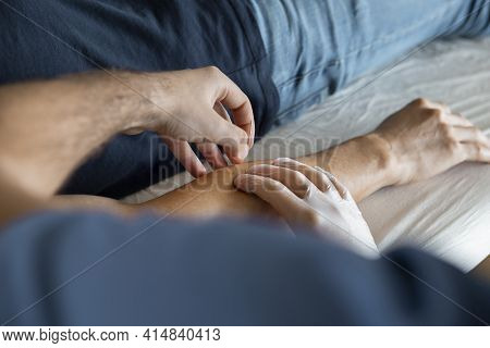 Physiotherapist First Point Of View Of His Hands In Surgical Gloves Introducing A Dry Needle Or Pull