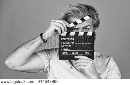 Cinema Production. Creative Producer. Bearded Man Hold Movie Clapper. Film Maker. Clapperboard Copy