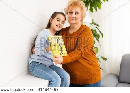 Canvas Print. Little Girl And Grandmother With Photo Canvas