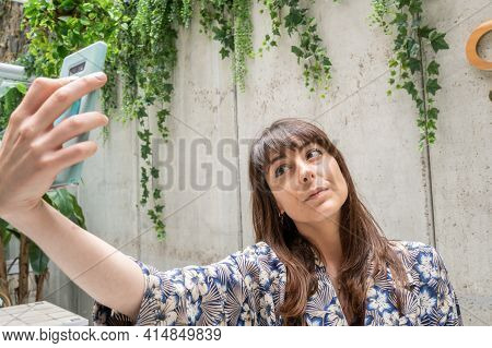 Beautiful And Stylish Female Model Taking A Selfie With Her Smart Phone