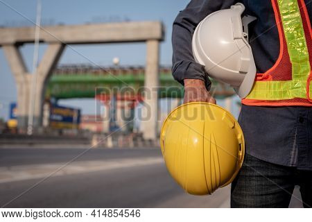 Yellow And White Helmet With An Engineer Who Built An Elevated Road
