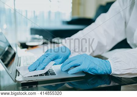 Scientists Are Cleaning Labtop By Alcohol And Tissue After Checking And Testing Virus On Labtop At H