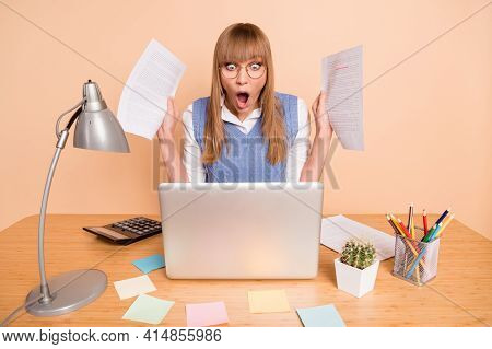 Photo Portrait Of Woman In Blue Vest Shocked Overwhelmed Staring With Documents Deadlines Isolated O