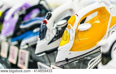 Poznan, Pol - Feb 24, 2021: Different Brands Of Electric Steam Irons Put Up For Sale In A Household
