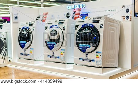 Poznan, Pol - Feb 24, 2021: Front-loader Washing Machines By Samsung Put Up For Sale In A Household