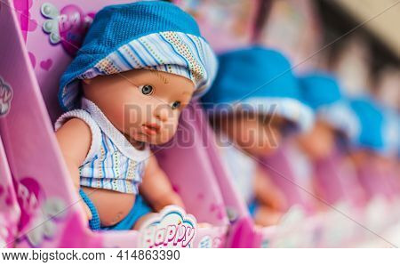 Children's Dolls Put Up For Sale On A Store Shelf