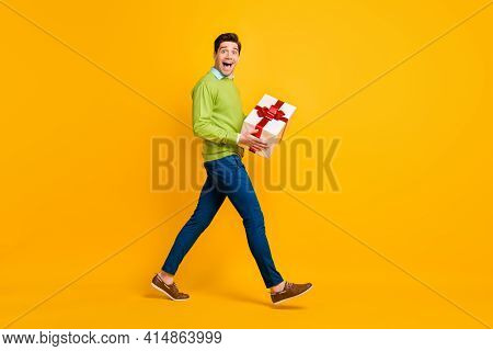 Full Length Body Size Profile Side View Of Nice Crazy Cheerful Guy Holding In Hands Giftbox Having F