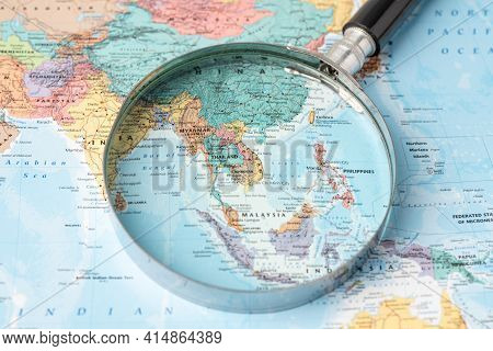 Bangkok, Thailand - November 01, 2020 Asia, Magnifying Glass Close Up With Colorful World Map