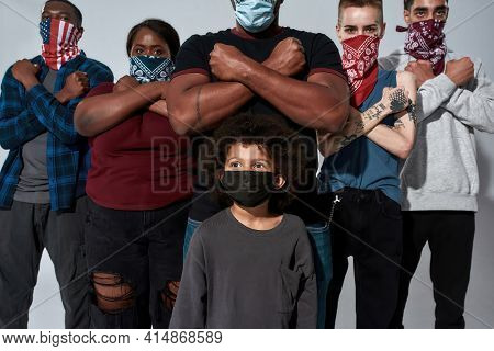 Young Multiracial People In Buffs And Masks Standing With Crossed Hands Side By Side During Anti Rac