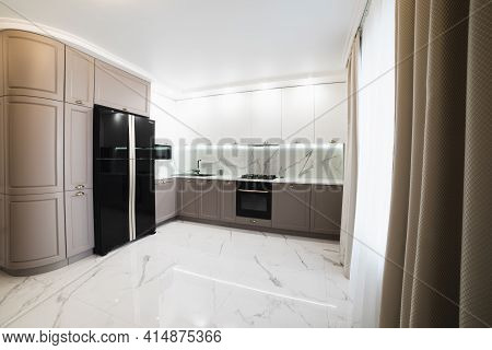 Interior Modern Furnished Kitchen. High Quality And Resolution Beautiful Photo Concept