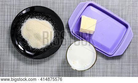Ingredients For Making Semolina Porridge. Semolina, Milk And Butter. Recipe. Top View.