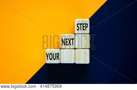 Your Next Step Symbol. Wooden Blocks Stacking As Step Stair On Top With Words Your Next Step. Busine
