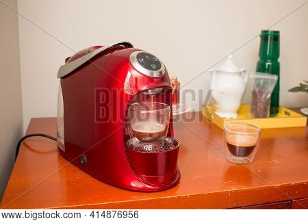 Stylish Red Espresso Coffee Maker For Brewing The Perfect Cup Of Coffee Or Espresso