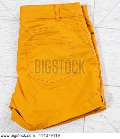 Folded Shorts Close Up Top View On Wooden Background