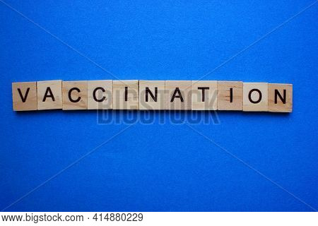 The Word Vaccination On A Blue Background. View From Above. A Word Of De-cheved Cubes. Flat. Medicin