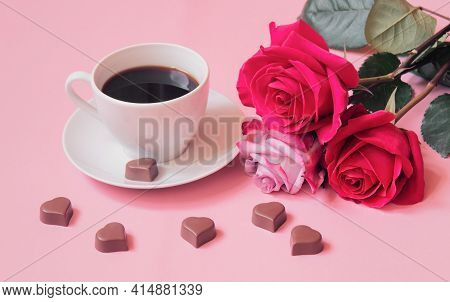 Cup Of Coffee, Heart Shape Chocolate Candies And Pink Roses. Selective Focus.