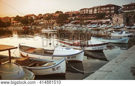 Nessebar, Bulgaria - July 20, 2014: Small Fishing Boats Are Moored In Old Port Of Nesebar. Vintage S